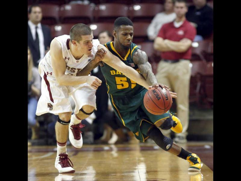 Boston College's Joe Rahon, left, fouls Baylor's Pierre Jackson, right, in an effort to steal the ball or stop the clock during late second half action of their NCAA basketball game at the 5th annual Charleston Classic in Charleston, S.C. at TD Arena. (AP Photo)
