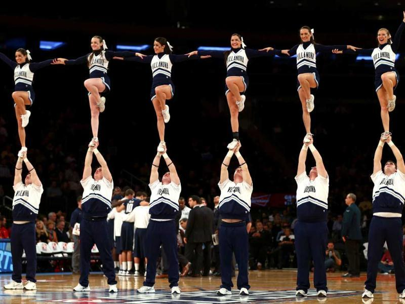 The Villanova Wildcats cheer squad performs during a time out in the first half against the Purdue Boilermakers during the 2012 2K Sports Classic at Madison Square Garden in New York City. (AFP Photos)