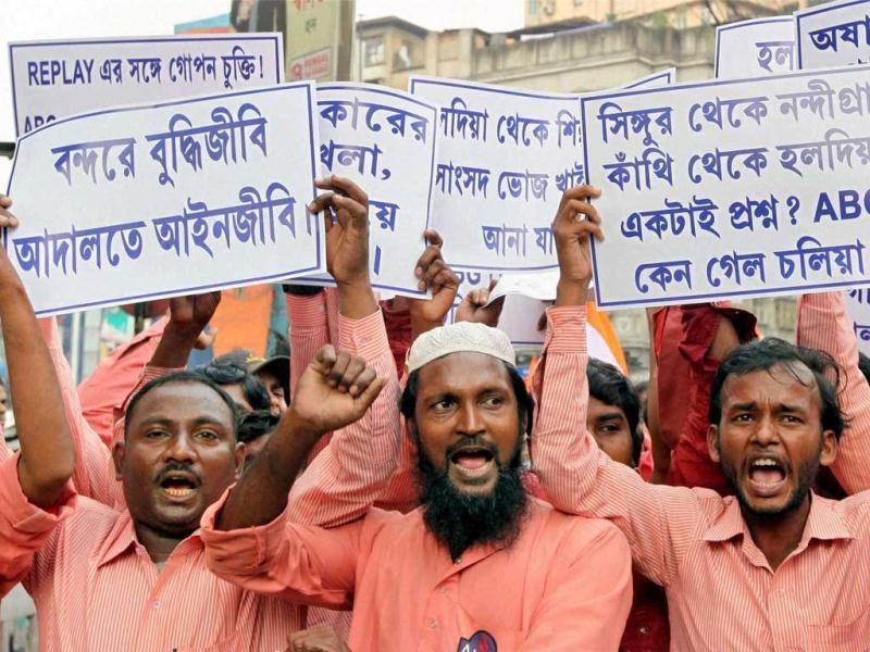 Activists of INTUC along with the workers of Haldia Port take part in a protest rally againist the West Bengal government in Kolkata. (PTI Photo)