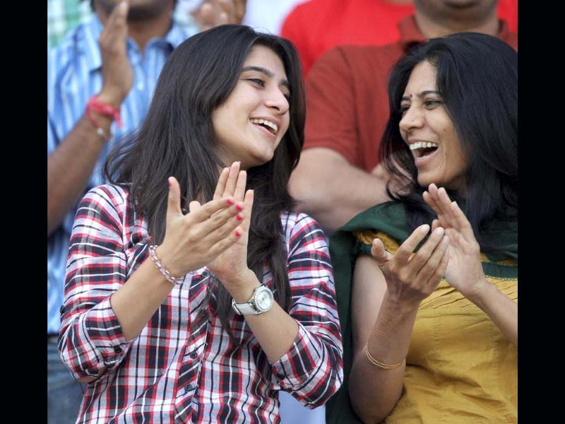 Cheteshwar Pujara's fiancee Puja (L) claps after he completes his century on Day 2 of the first cricket test match against England, at Motera in Ahmedabad on Friday. PTI Photo by Shirish Shete(PTI11_16_2012_000017B) Cheteshwar Pujara's fiancee Puja (L) claps after he completes his century on Day 2 of the first cricket test match against England, at Motera in Ahmedabad. PTI Photo by Shirish Shete