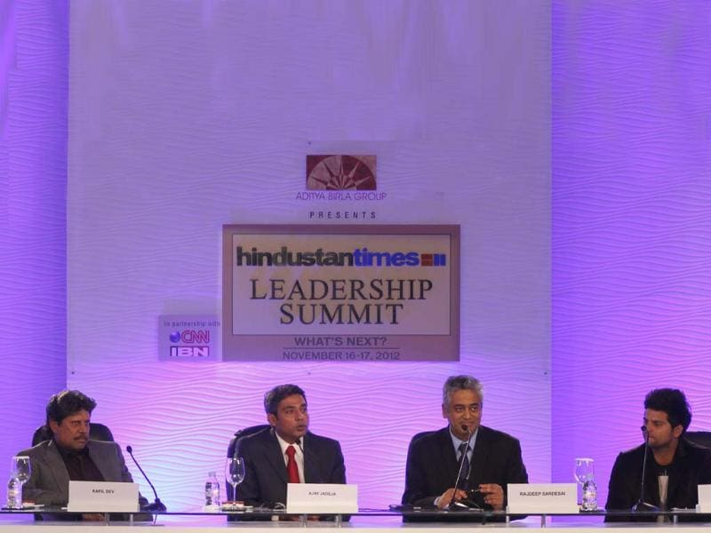 Former cricketer Kapil Dev along with cricketers Suresh Raina and Ajay Jadeja and moderator Rajdeep Sardesai before the sixth session of Hindustan Times Leadership Summit at Taj Palace in New Delhi. (Photo by MAHENDRA PARIKH/ Hindustan Times)