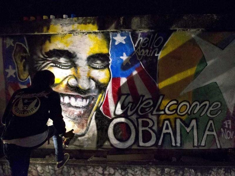Artist Arker Kyaw paints a graffiti welcoming U.S. President Barack Obama in Yangon, Myanmar. (AP Photo)