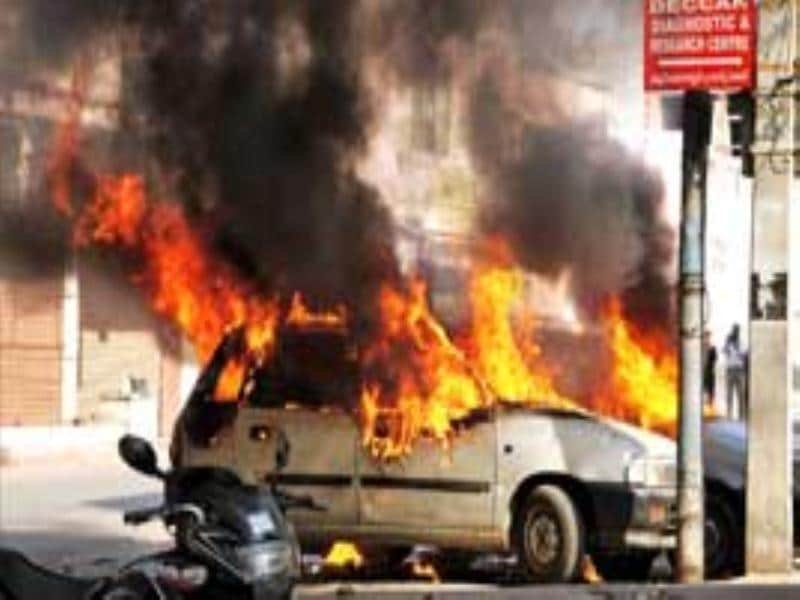 Vehicles in flames at Kalikaman after an incident of violence in old city of Hyderabad. (PTI Photo)