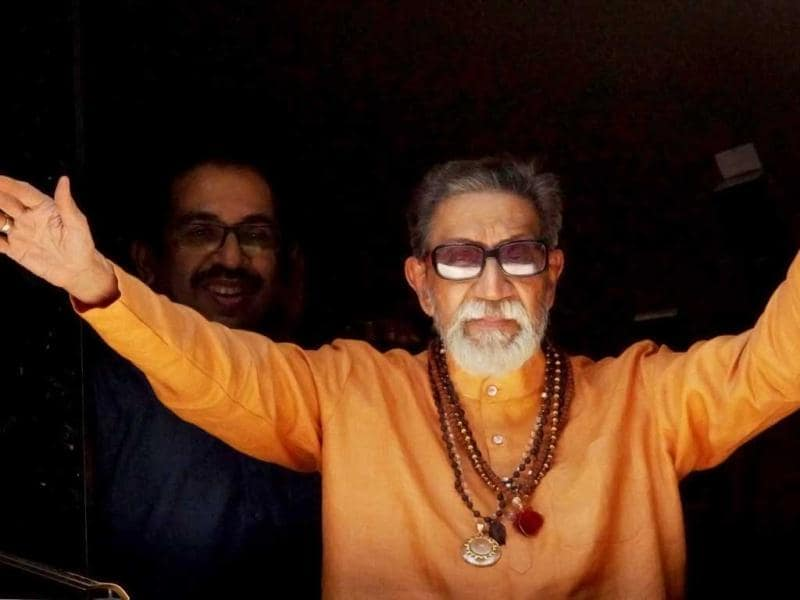 In this file photo Shiv Sena supremo Bal Thackeray waves at party workers gathered outside his residence Matoshree in Mumbai. PTI