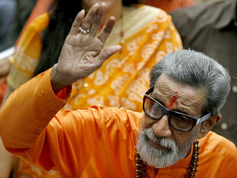 Shiv Sena chief Bal Thackeray waves towards the media as he arrives to cast his vote at a polling centre during the Maharashtra state elections in Mumbai. Reuters