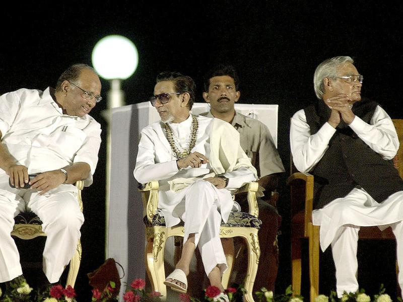 File photo: Shiv Sena chief Bal Thackeray is seen talking to Sharad Pawar at the release ceremony of a pictorial biography on his life, as former Prime Minister Atal Behari Vajpayee looks on in Mumbai. AP