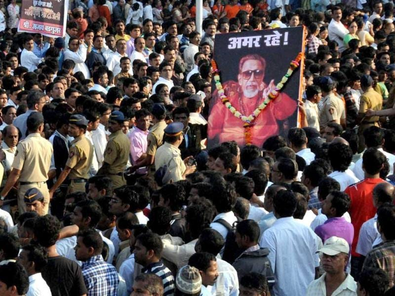 Thousands of Bal Thackeray supporters throng to his final procession as his body is carried from his residence to Shivaji Park in Mumbai. PTI Photo