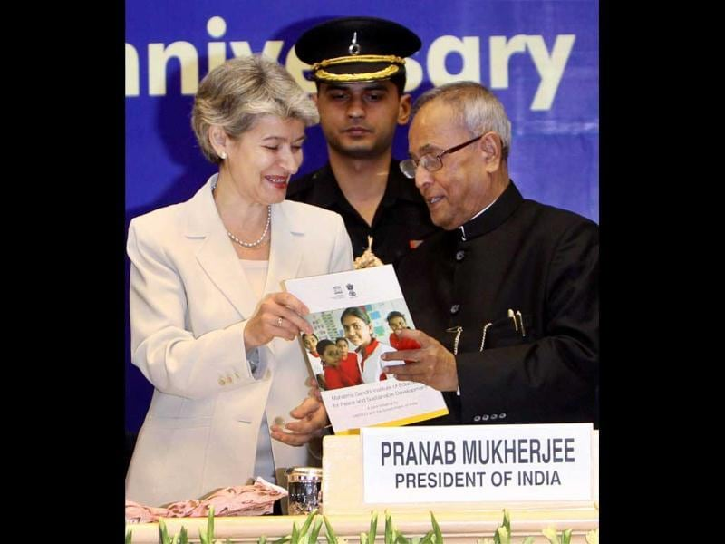 Director General of UNESCO, Irina Bokova, presents a brochure to President Pranab Mukherjee during a function to celebrate World Education Day 2012 in New Delhi. (PTI Photo)