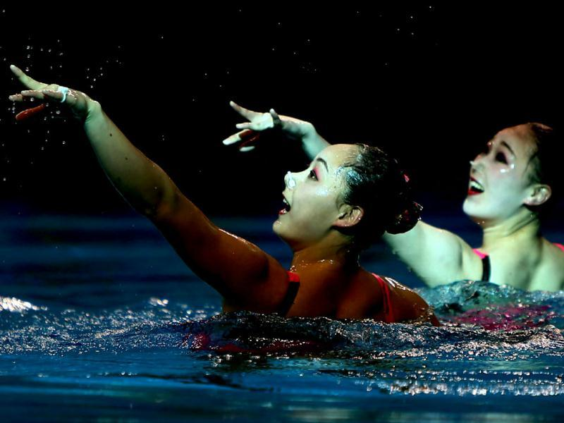 Kim Jong-Hui and Ri Ji Hyang of Democartic People's Republic of Korea perform in the Duets Free Routine Syncronised swimming final during the 9th Asian Swimming Championships in Dubai. AFP Photo