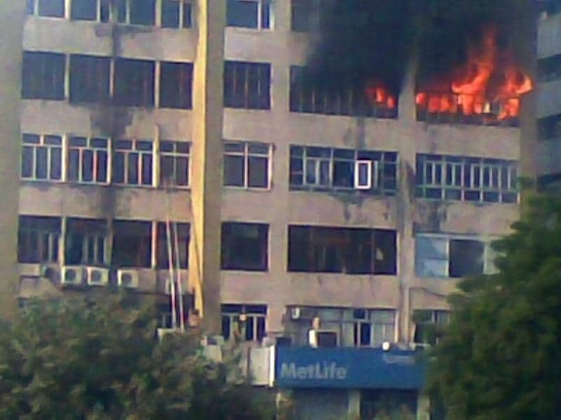 Fire is seen raging at the Himalaya House in New Delhi's Connaught Place. HT