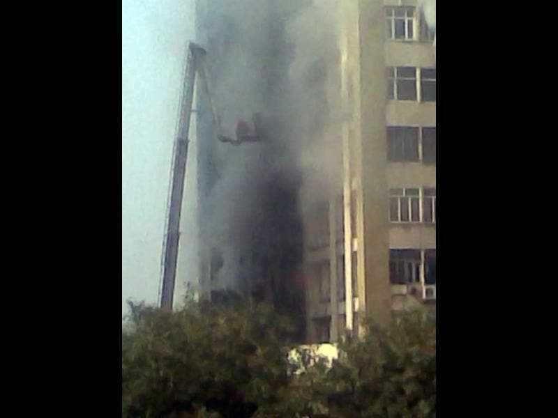 Fire fighters struggle to control the fire at Himalaya House in New Delhi's Connaught Place. HT