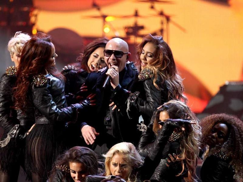 "Pitbull performs ""Don't Stop the Party"" at the 40th Anniversary American Music Awards, in Los Angeles. (Photo by Matt Sayles/Invision/AP)"