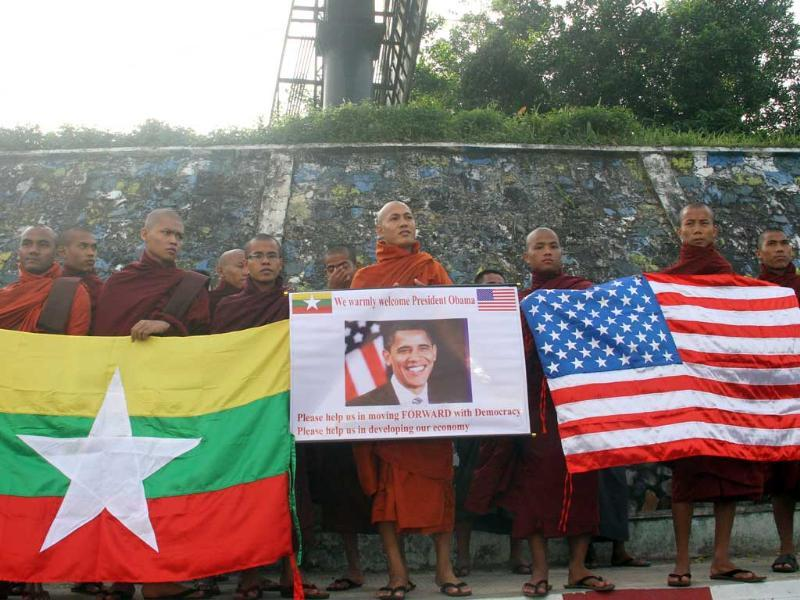 Myanmar Buddhist monks wait to welcome the arrival of U.S. President Barack Obama at Yangon International airport in Yangon, Myanmar. (AP Photo/Khin Maung Win)