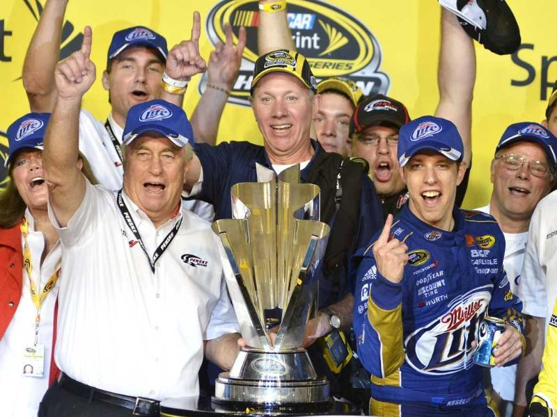 Racing legend and car owner Roger Penske (L) celebrates with his driver Brad Keselowski (R) after he won the Sprint Cup during the 2012 Ford EcoBoost 400 Sprint Cup NASCAR race at the Homestead-Miami Speedway in Homestead, Florida. REUTERS/Gaston De Cardenas