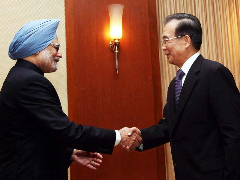 Prime Minister Manmohan Singh shakes hands with Chinese Premier Wen Jiabao during a Bilateral Meeting in Phnom Penh, Cambodia. PTI Photo by Kamal Singh