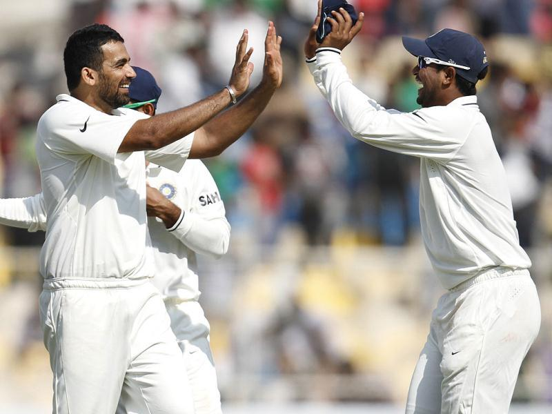 Bowler Zaheer Khan celebrates with Ajinkya Rahane after taking the wicket of Tim Bresnan during the final day of first Test match at Sardar Patel Stadium in Motera, Ahmadabad. HT/Mohd Zakir