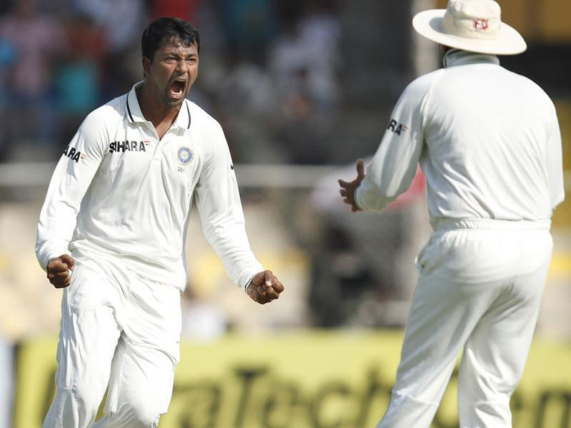 Bowler Pragyan Ojha celebrates the wicket of Alastair Cook during the final day of first Test match at Sardar Patel Stadium in Motera, Ahmadabad. HT/Mohd Zakir