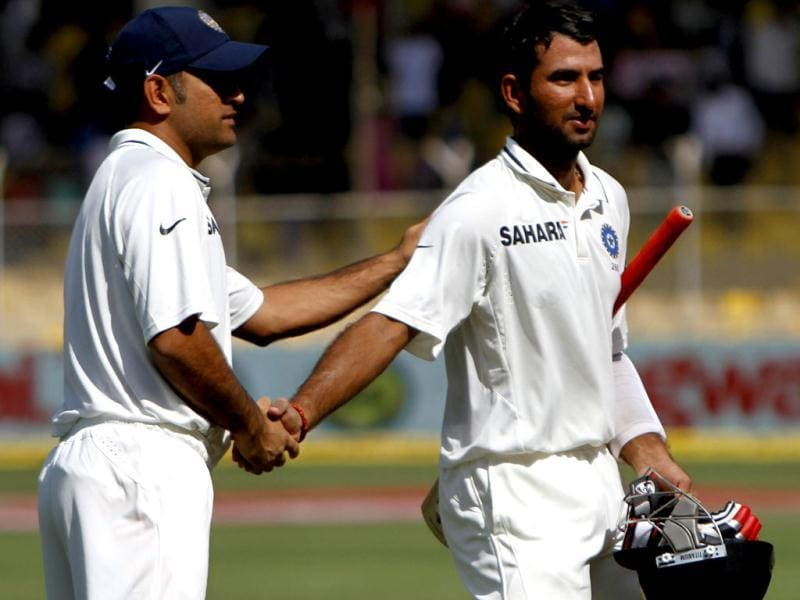 Captain MS Dhoni appriciates team batsman Cheteshwar Pujara after winnig over England during the final day of first Test match at Sardar Patel Stadium in Motera, Ahmadabad. HT/Mohd Zakir