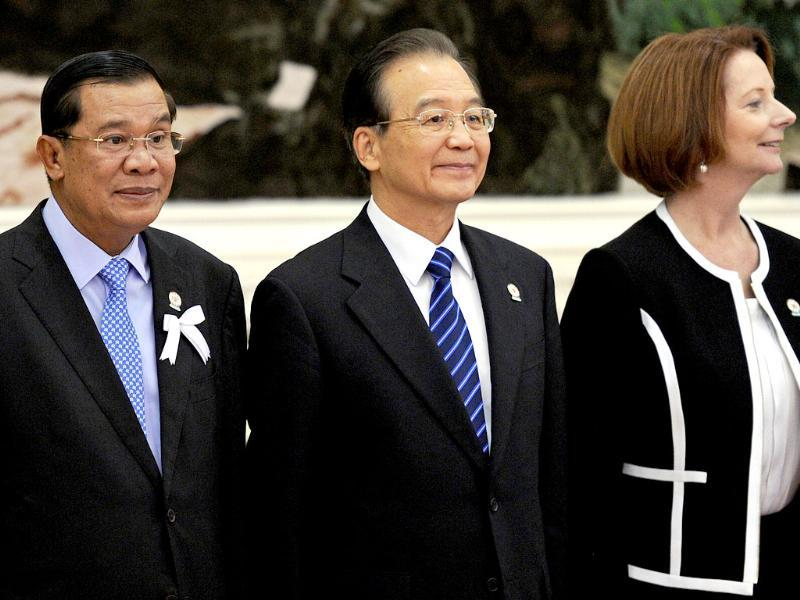 Cambodian Prime Minister Hun Sen, Chinese Prime Minister Wen Jiabao and Australian Prime Minister Julia Gillard stand for a picture ahead of the 7th East Asia Summit in Phnom Penh. AFP