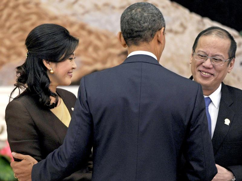 US President Barack Obama greets Thai Prime Minister Yingluck Shinawatra and Philippines President Benigno Aquino ahead of a picture preceding the 7th East Asia Summit in Phnom Penh. AFP