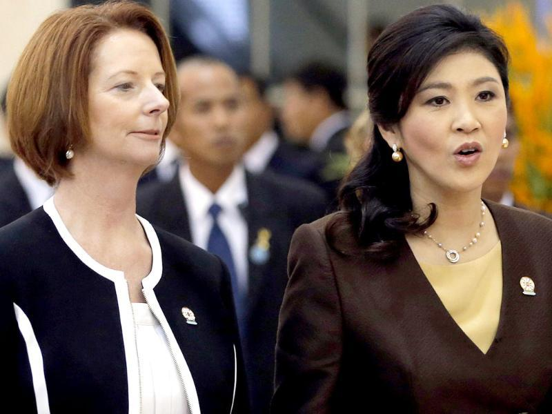 Australia's Prime Minister Julia Gillard and Thailand's Prime Minister Yingluck Shinawatra arrive for the Plenary session of the 21st ASEAN (Association of Southeast Asian Nations) and East Asia summits in Phnom Penh. Reuters