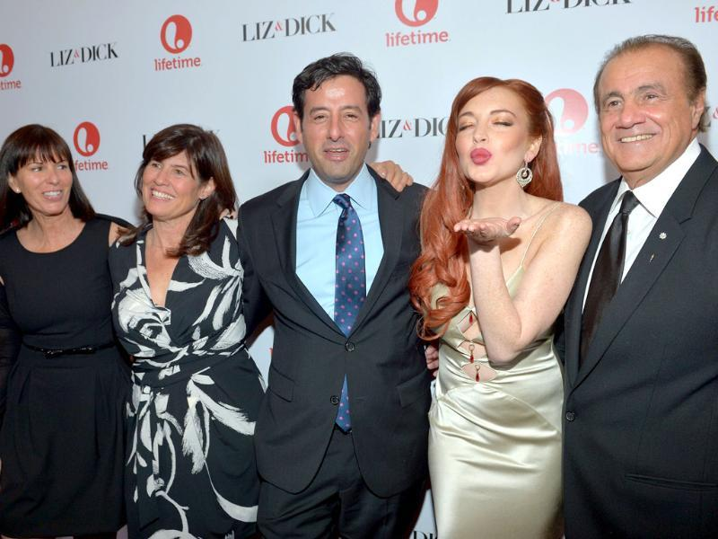 Nancy Bennett, Tanya Lopez, Rob Sharenow, actress Lindsay Lohan, and executive producer Larry Thompson attend a private dinner for the Lifetime premier of