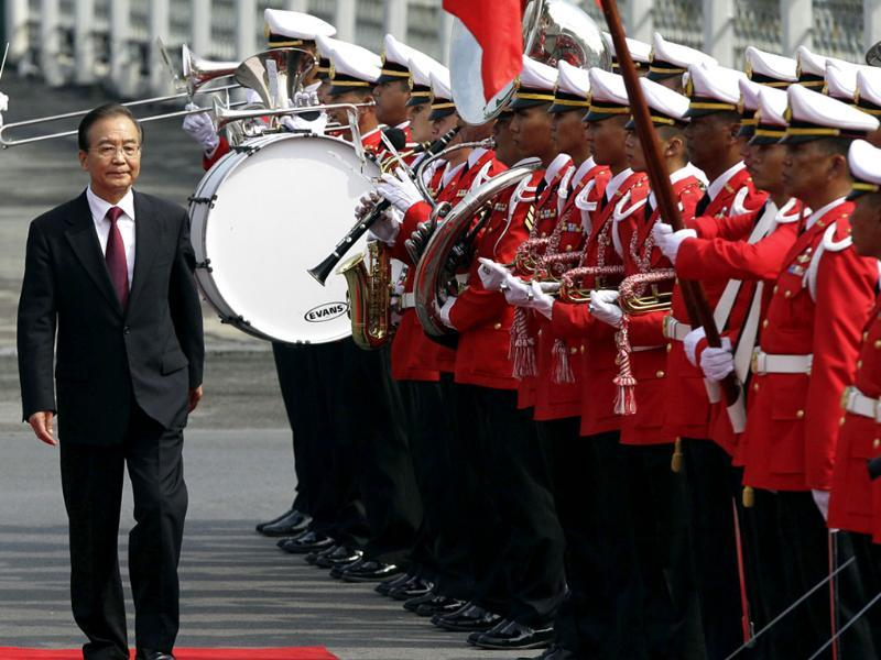 Chinese Premier Wen Jiabao reviews an honor guard during a welcome ceremony at the government house in Bangkok, Thailand. Wen is on a two-day visit to Thailand as part of a regional tour before he steps down next year. AP/Sakchai Lalit