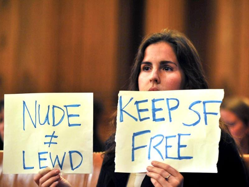 Tailor Whitfield holds up a sign during a Board of Supervisors meeting in San Francisco's City Hall. San Francisco lawmakers voted to outlaw most public nudity, despite protests in the famously free and easy California city. AFP/Josh Edelson