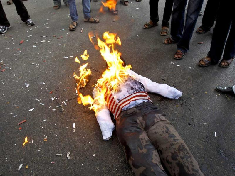 Activists of Akhil Bharatiya Vidyarthi Parishad, or All Indian Student Council, burn an effigy of Mohammed Ajmal Kasab, the lone surviving gunman from the 2008 terror attacks on Mumbai, to celebrate the news that he was executed, in Bangalore. (AP Photo/Aijaz Rahi)