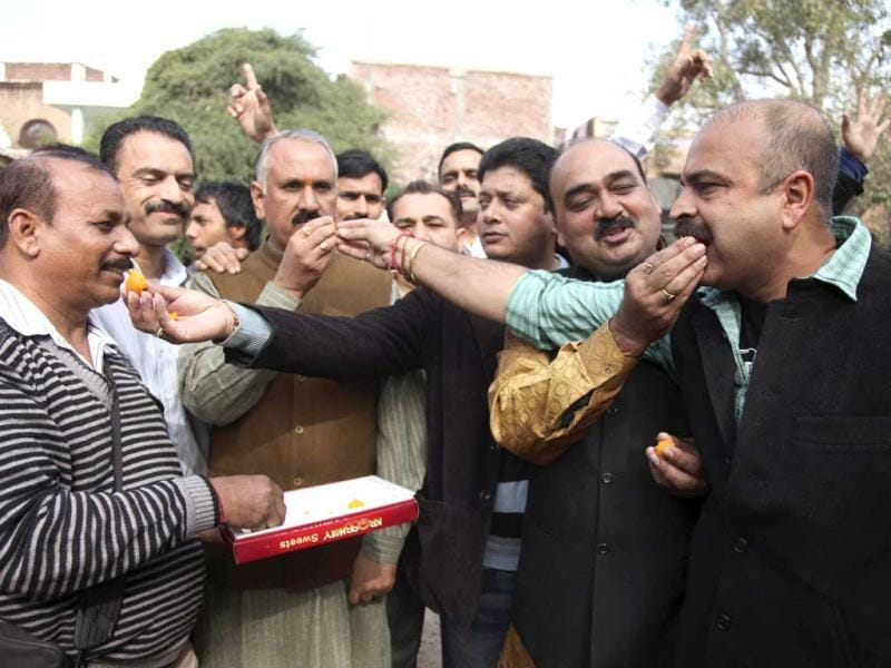 Bharatiya Janata Party activists distribute sweets to celebrate the news of India executing Mohammed Ajmal Kasab, the lone surviving gunman from the 2008 terror attacks, in Jammu. (AP Photo/Channi Anand)