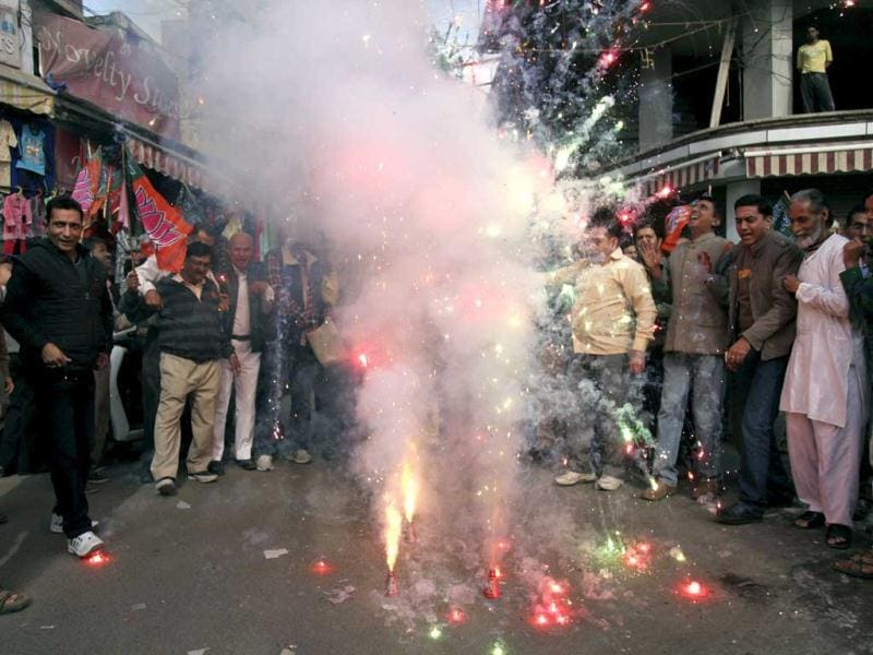 Bharatiya Janata party activists light firecrackers to celebrate the news of Mohammed Ajmal Kasab's execution, in Jammu. India executed the lone surviving gunman from the 2008 terror attack on Mumbai early, the home ministry said. (AP Photo/ Channi Anand)
