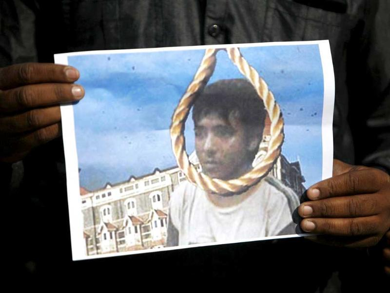 A man holds a picture of Mohammad Ajmal Kasab with a noose, as he celebrates Kasab's execution, in Ahmedabad. Reuters