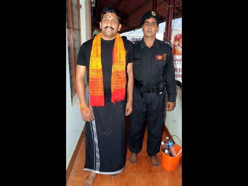 NSG commando P V Maneesh, who was injured and paralysed during the 26/11 Mumbai terror attacks, visits Sabarimala temple after Kasab's execution. (PTI Photo)
