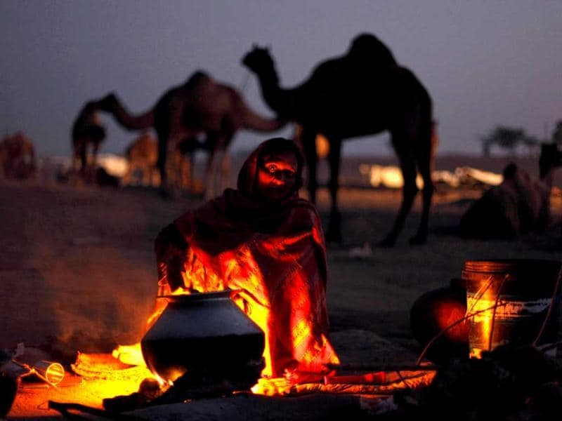 A woman prepares food early morning at the annual cattle fair in Pushkar, Rajasthan. AP