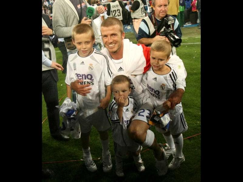David Beckham poses with his sons after Real won the Spanish league title by beating Mallorca in the final Spanish league football match of the season, 17 June 2007 at the Santiago Bernabeu stadium in Madrid. Real won 3-1 to win their 30th league title. AFP Photo