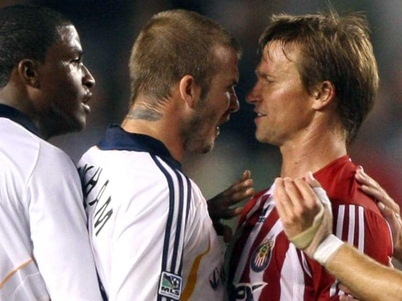 David Beckham of the Los Angeles Galaxy confronts Chivas USA's Jesse Marsch (2R) after Beckham was tacked by Marsch in first half MLS action, 23 August 2007 at the Home Depot Center in Carson, California. AFP Photo