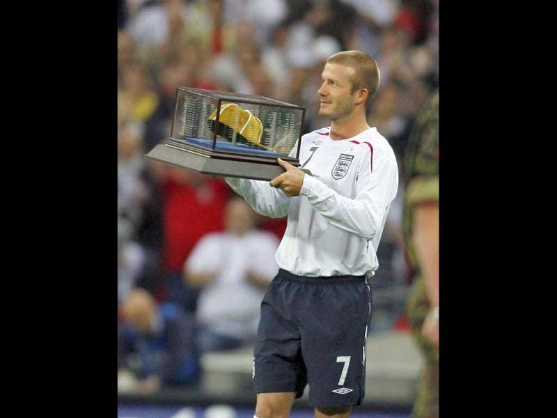 David Beckham receives his 100th cap award before kick off of their International friendly between England and USA on May 28, 2008 at Wembley Stadium in London. England won 2-0. AFP Photo