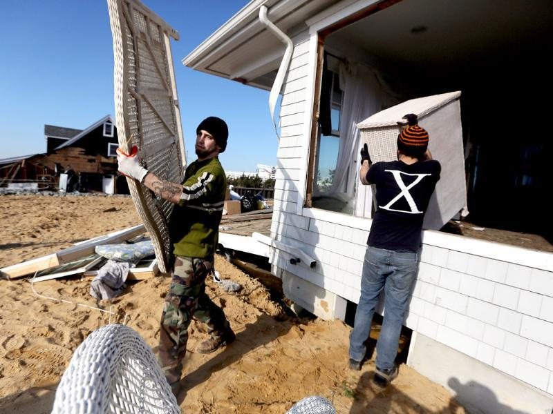 Workers remove items from a damaged home in Mantoloking, New Jersey. Mantoloking was one of the hardest hit areas by Superstorm Sandy. AFP/Mario Tama/Getty Images