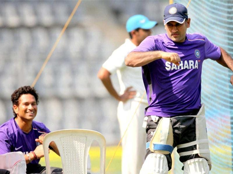 Skipper MS Dhoni and Sachin Tendulkar during a practice session at Wankhade Stadium in Mumbai. PTI