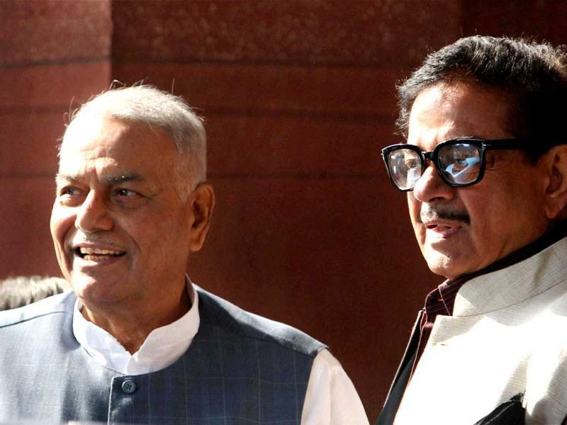 BJPleaders Yashwant Sinha and Shatrughan Sinha at Parliament House on the first day of its winter session in New Delhi. PTI Photo