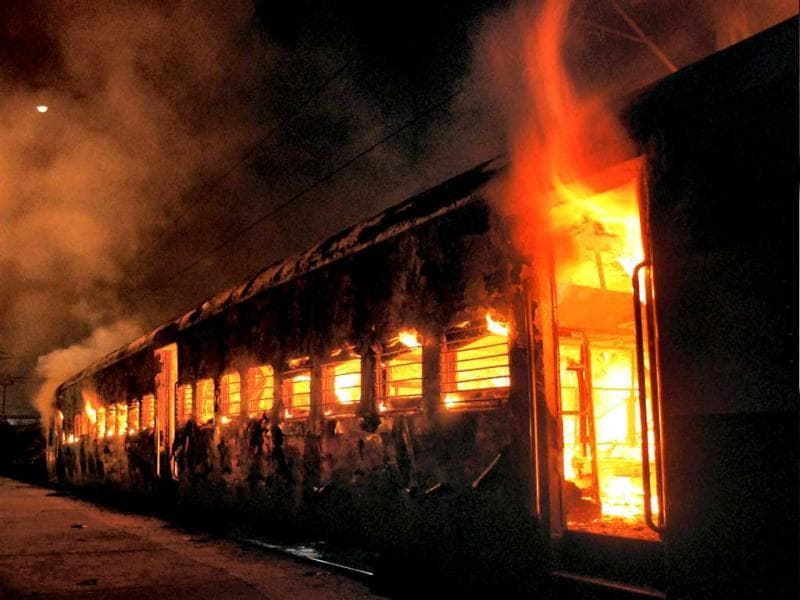 A coach of Ernakulam Express catches fire after short-circuit at Patna Junction. PTI Photo