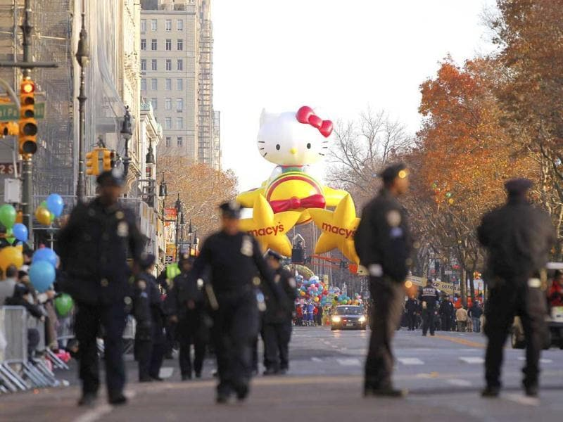 Policemen walk along Central Park West as the Hello Kitty balloon waits for the start of the 86th Macy's Thanksgiving Day Parade in New York. Reuters/Gary Hershorn