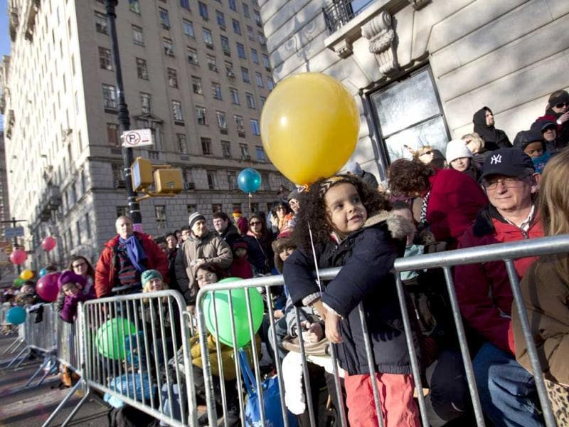 People line Central Park West for the 86th Macy's Thanksgiving Day Parade in New York. Andrew Kelly/Getty Images/AFP