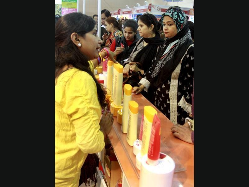 Women visit a pavilion displaying beauty products during the 32nd India International Trade Fair at Pragati maidan in New Delhi. (HT Photo/Sonu Mehta)