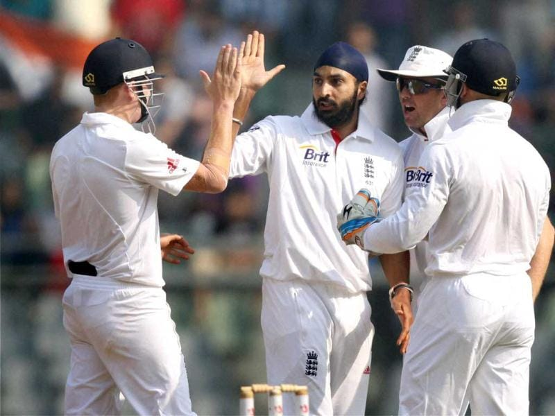 England's Monty Panesar celebrates the wicket of R Ashwin with teammates during Day 2 of second India-England test match at Wankhade Stadium in Mumbai. PTI