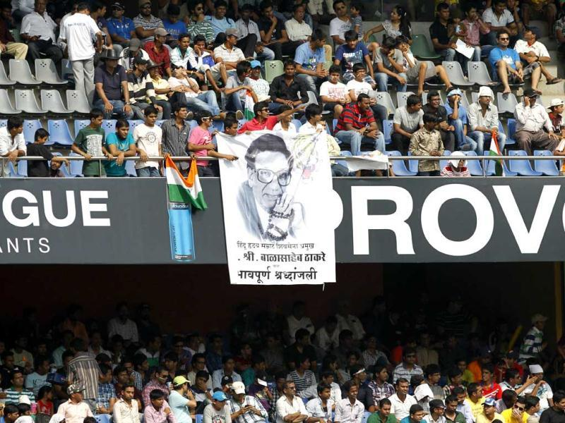 Fans display Bal Thackeray poster during 2nd day of 2nd test cricket match between India vs England at Wankhede stadium, in Mumbai. Hindustan Times