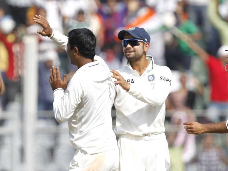 Team India celebrating after England's batsman Nick Compton got out during 2nd day of 2nd test cricket match between India vs England at Wankhede stadium, in Mumbai. Hindustan Times