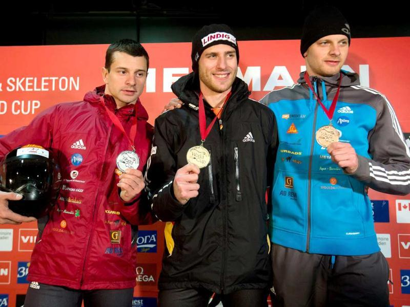 Race-winner Frank Rommel (C) of Germany, is flanked by Latvia brothers, second-place finisher Martins Dukurs (L) and his brother, third-place winner Tomass Dukurs (R) as they pose with their medals after the men's World Cup skeleton event in Whistler, British Columbia. AP Photo
