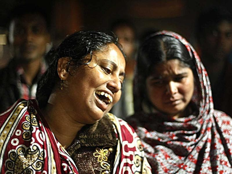 Bangladeshi women react at the scene of a fire at a garment factory in the Savar neighborhood in Dhaka, Bangladesh. AP Photo
