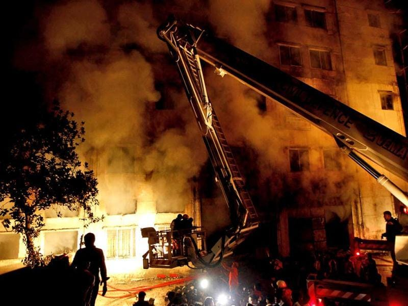 Bangladeshi firefighters battle a fire at a garment factory in the Savar neighborhood in Dhaka, Bangladesh. AP Photo